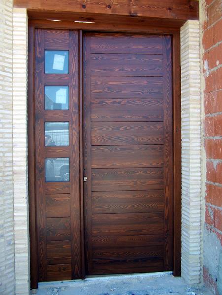 Puerta dos pliegues tablas horizontales
